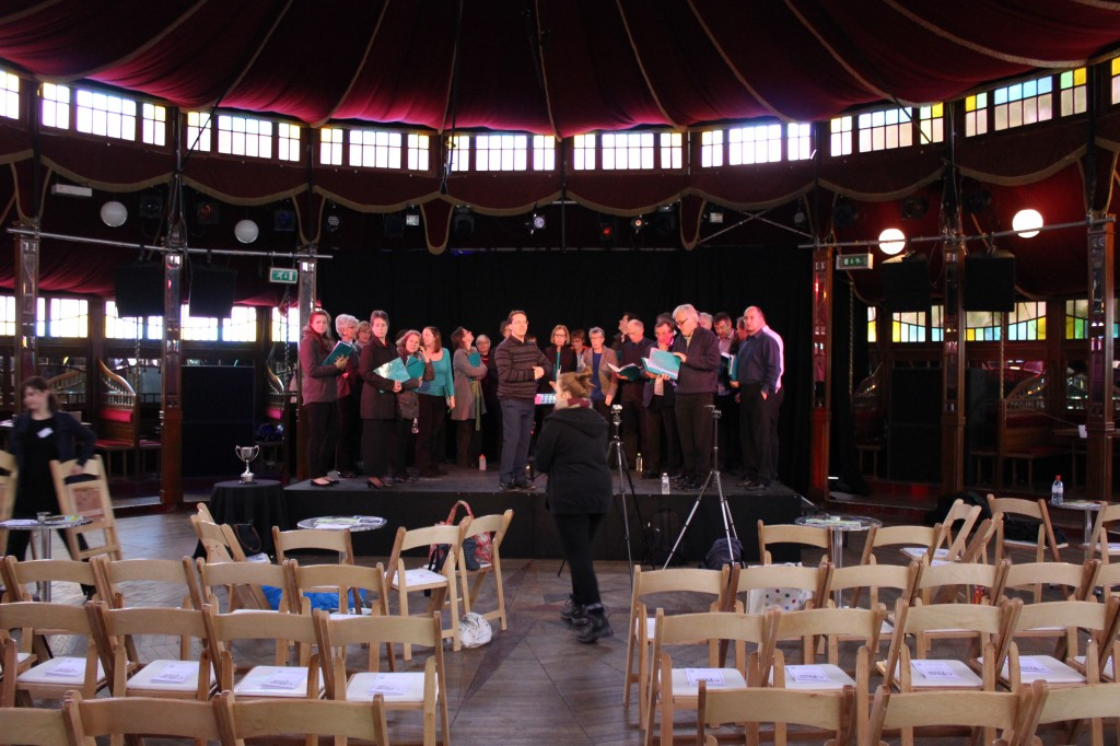 Choir practising in the Spiegeltent